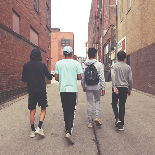 High School boys walking in ally