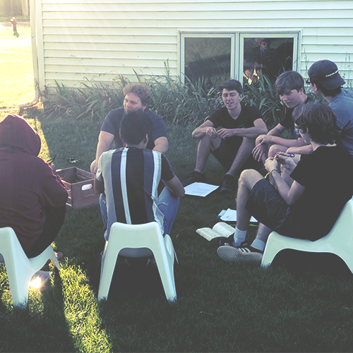 Group of highschool boys gathered in a circle